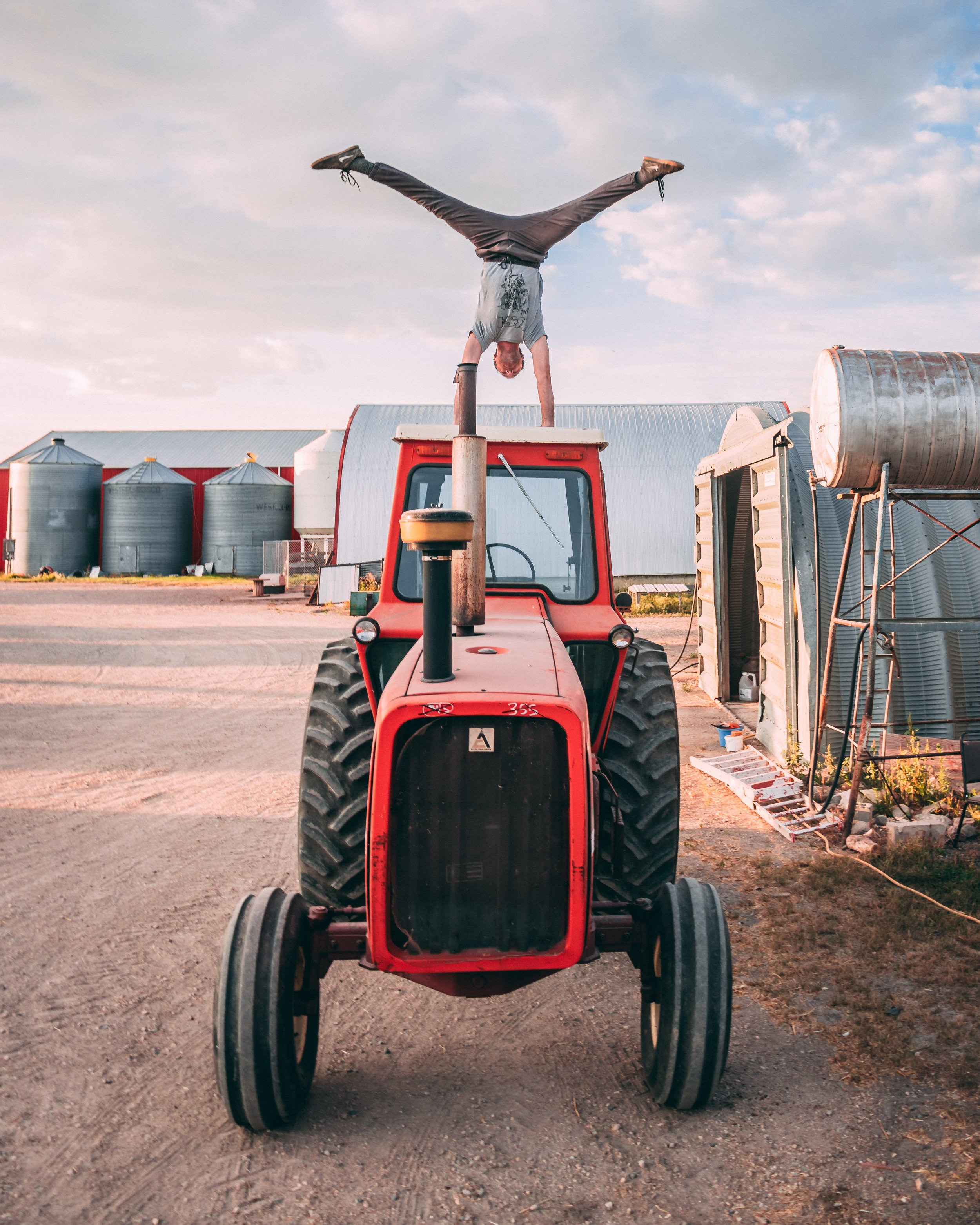 Man doing handstand on tractor