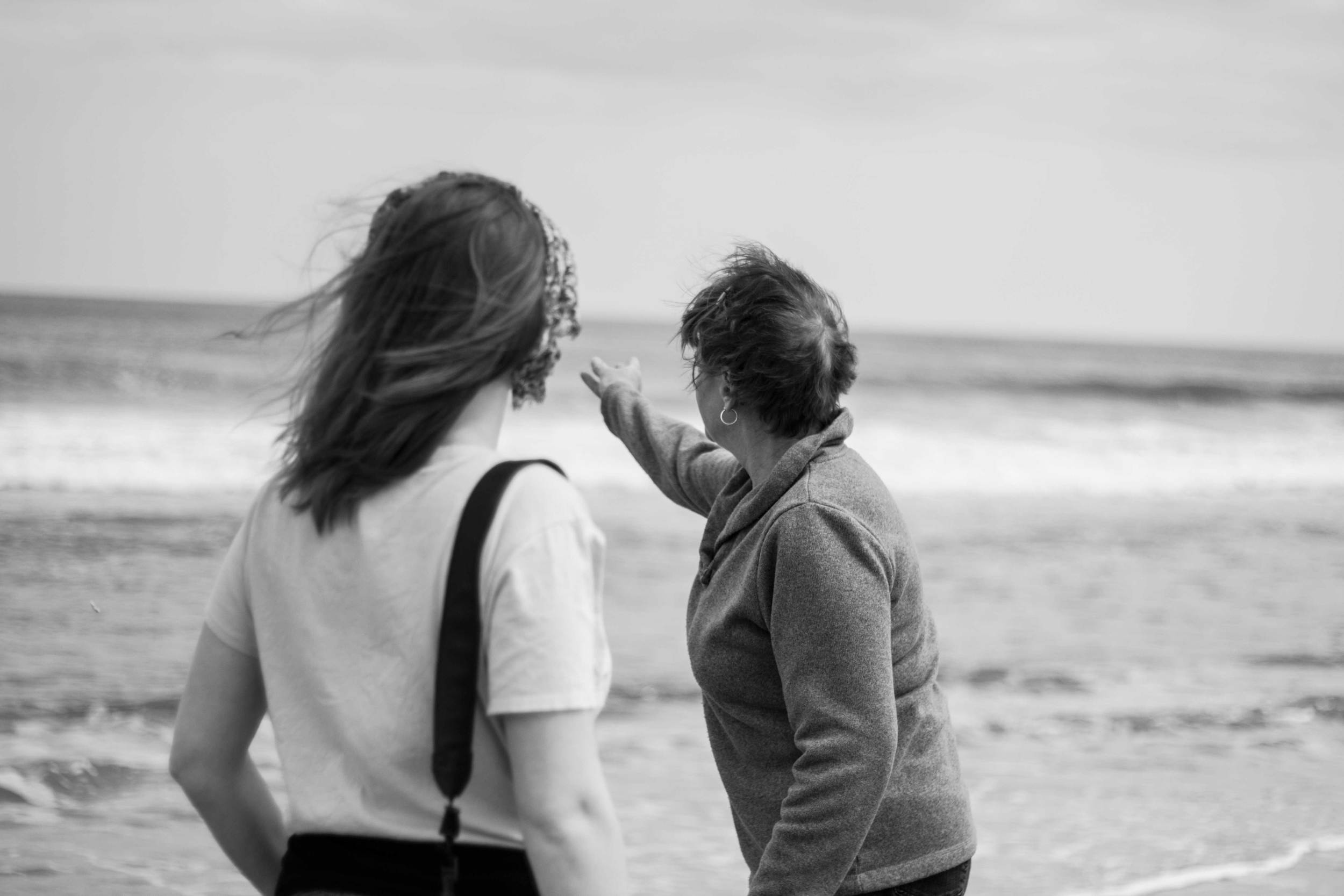 """This photo is from last summer, and is of a daughter and mother, throwing a seashell into the ocean to honor the mother's late brother; in essence, a family reunion."""