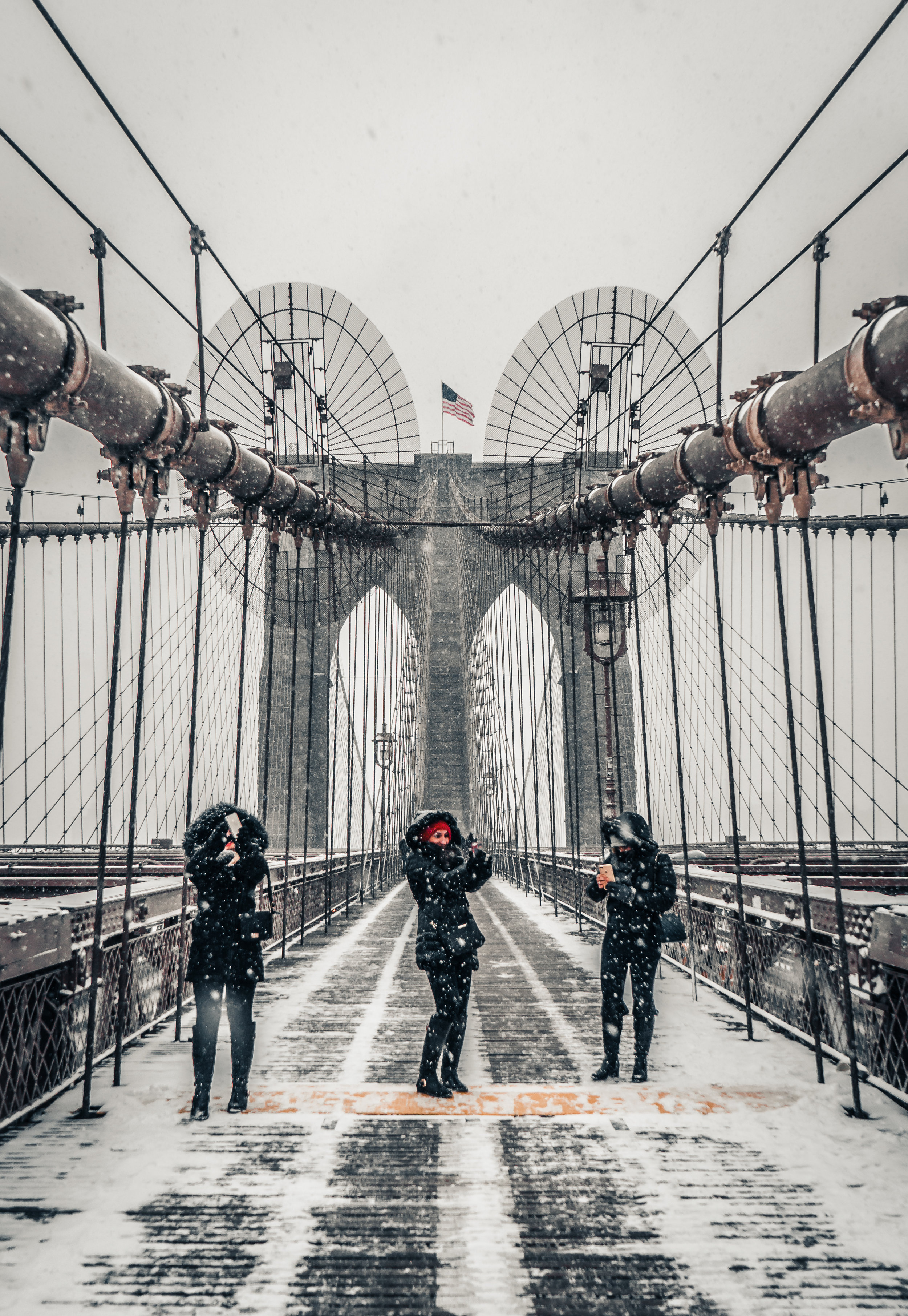 I love capturing candid moments and people acting natural. These three girls all snapping separate selfies on the Brooklyn Bridge is another favorite.