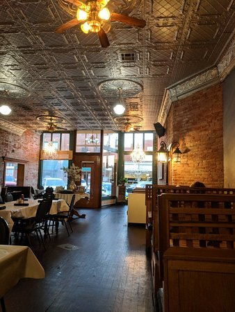 Stacy's Place  with it's hardwood floors, brick walls, and beautiful hand-painted murals surround diners with historical scenes reminiscent of the early days in Oklahoma.