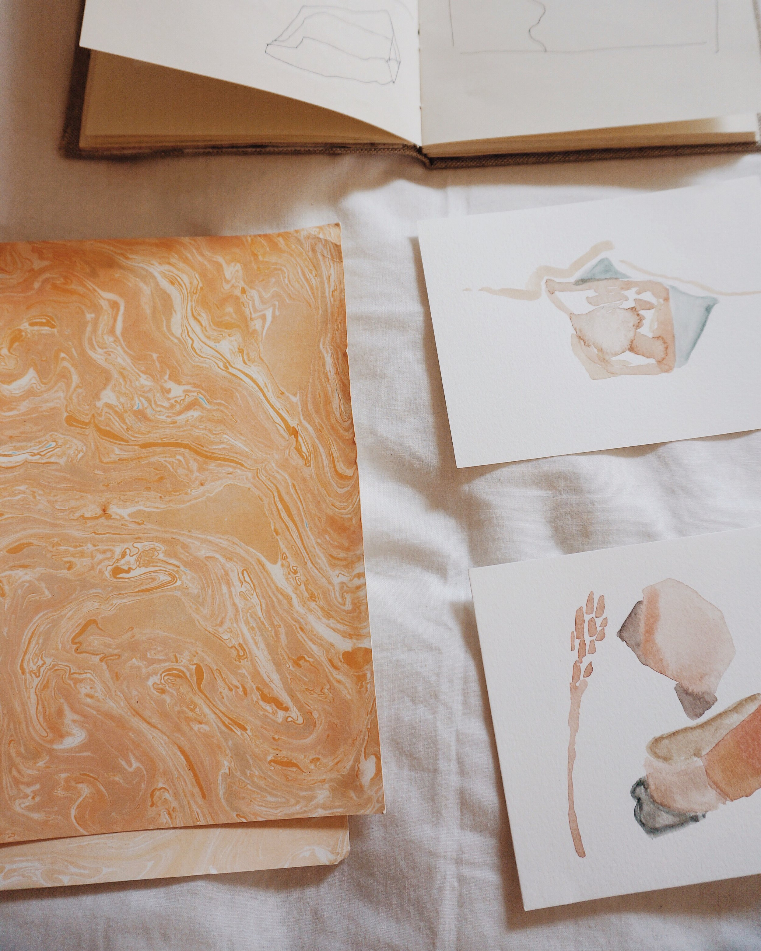 left, marbled paper from moab. right, sketches from a hike at rocky mountain national park.