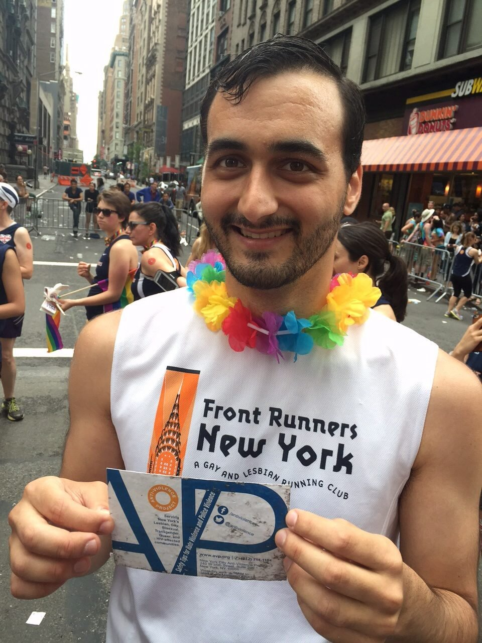Me at NYC Pride 2015, holding one of the weathered cards that I had designed for AVP.