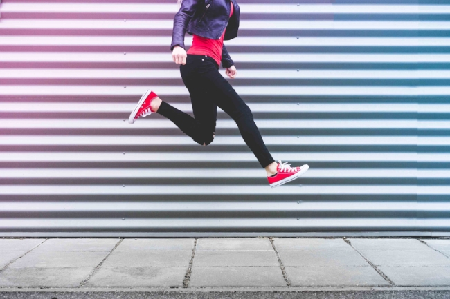 young-happy-woman-jumping-in-front-of-metal-wall-picjumbo-com.jpg