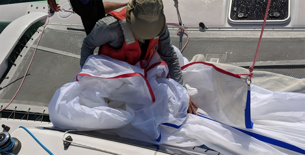 Training on the Corsair 760 tests your skill as much as your knowledge. Packing the spinnaker.