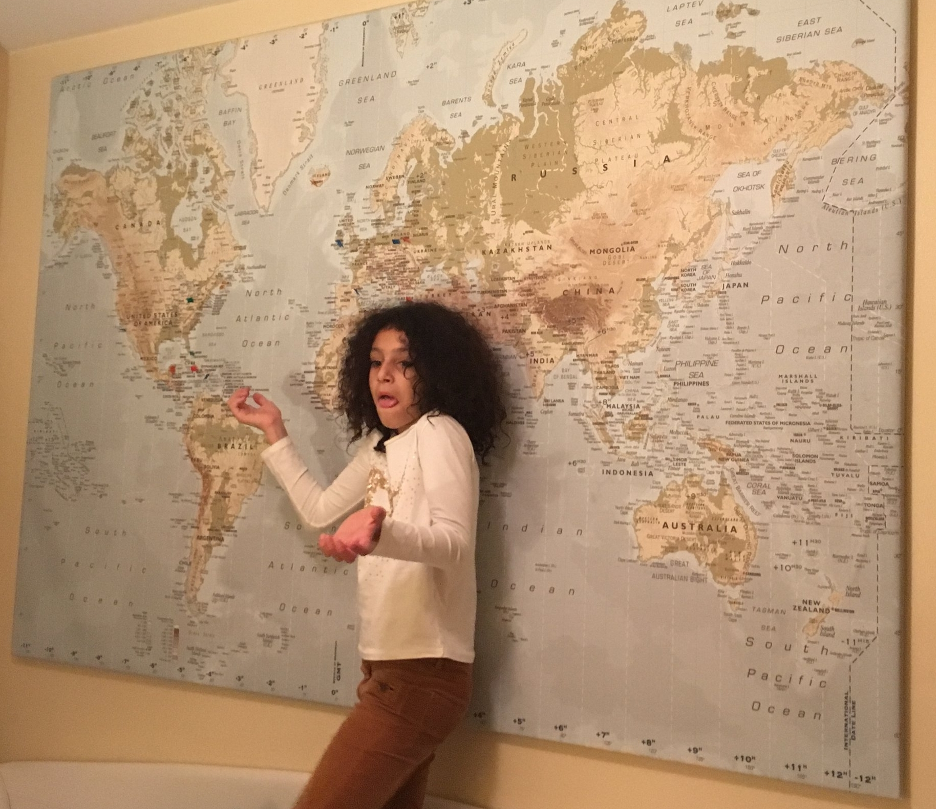 Space is at a premium in my friend's New York City apartment, but this young map enthusiast decided one wall needed a pushpin map of her family's adventures