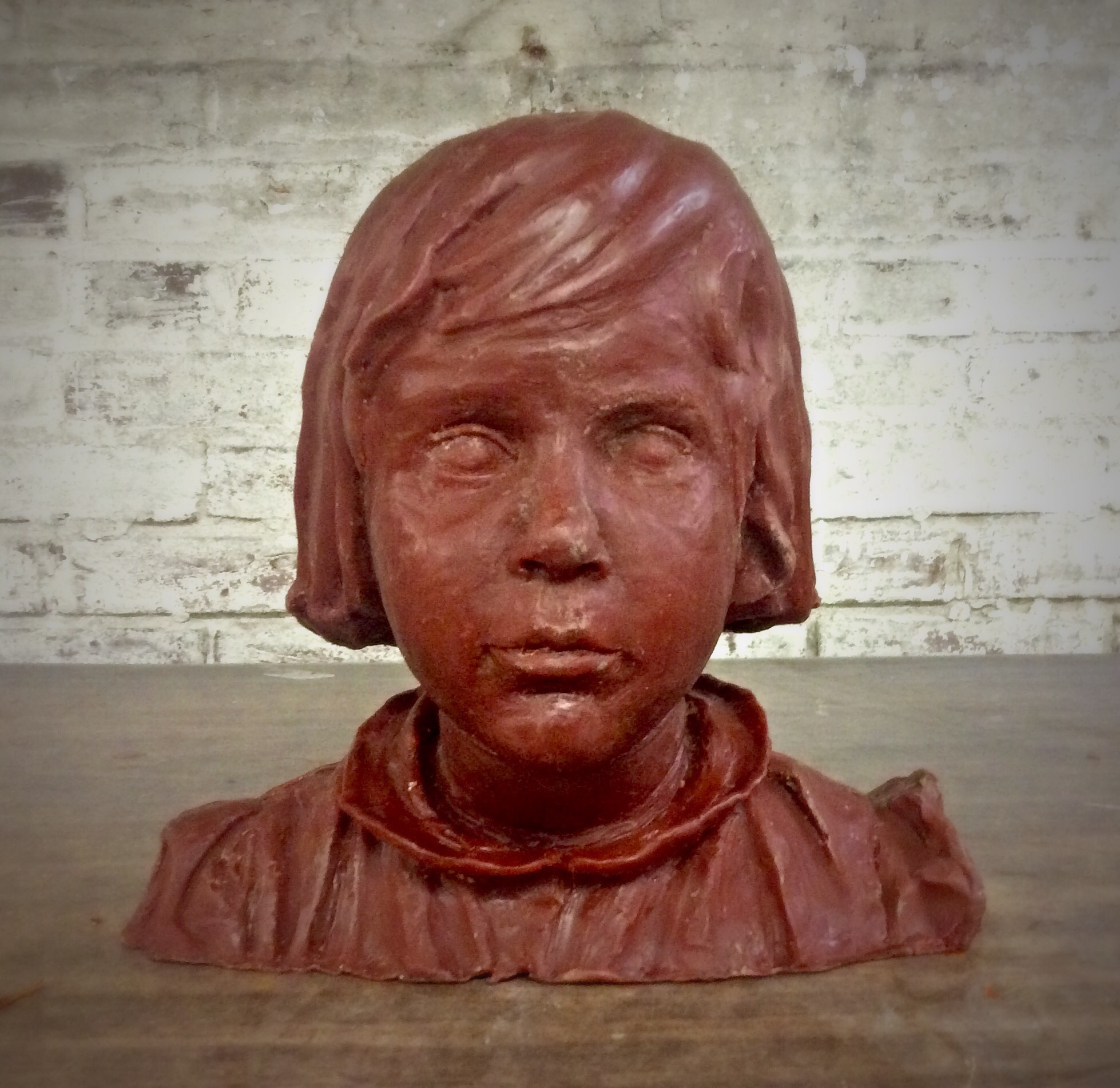 Karen Mcknney's father sculpted this bust of her as a child. The original clay was very old and dry, but stood up to the mold process. The wax came out great! Soon the sculpture will in bronze and last forever!