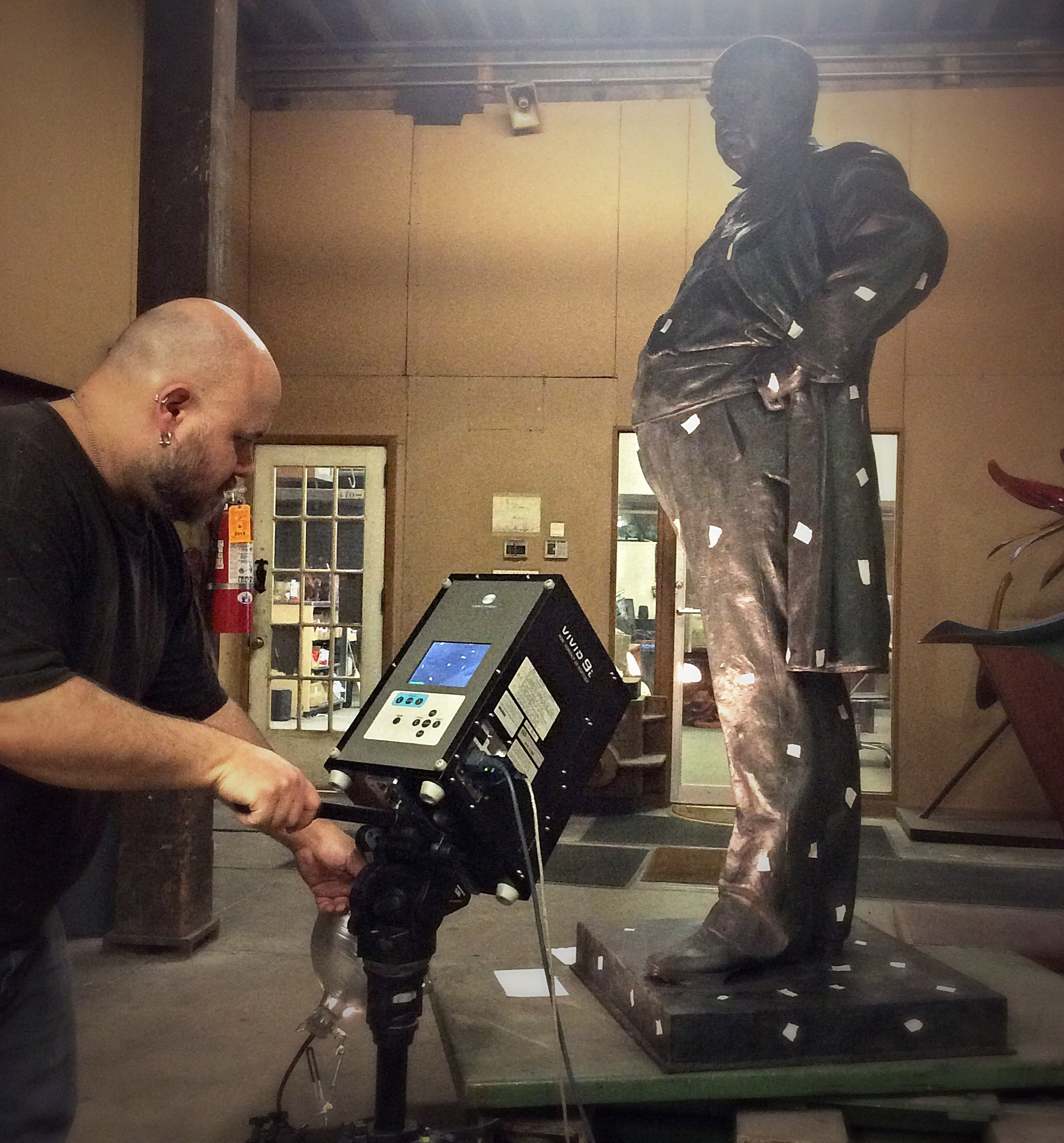 Using tape as registration markers to make a digital 3d file of the Robert G. Ingersol statue.