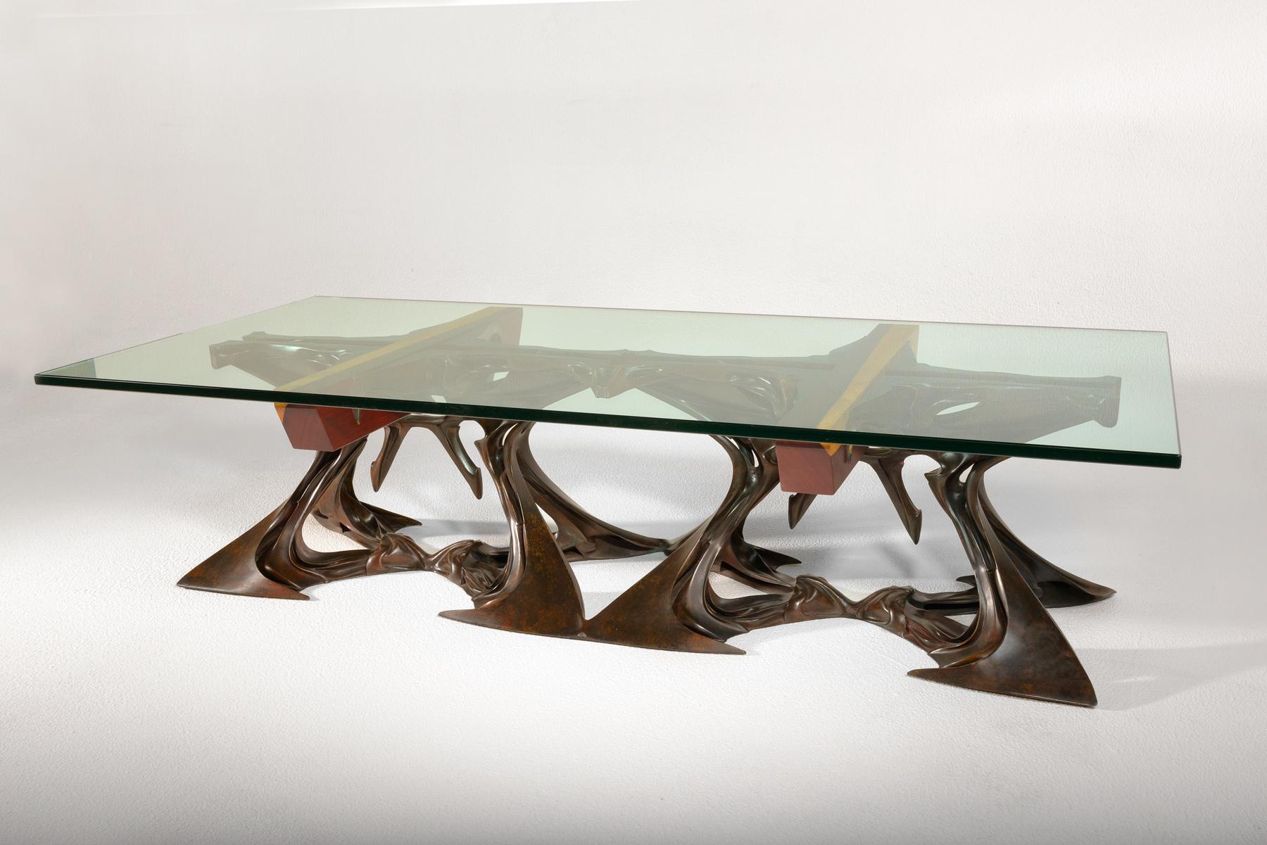 Vatskatabel    by Lawrence Welker IV   69″l x 32″w x 17″h   bronze, glass, bloodwood