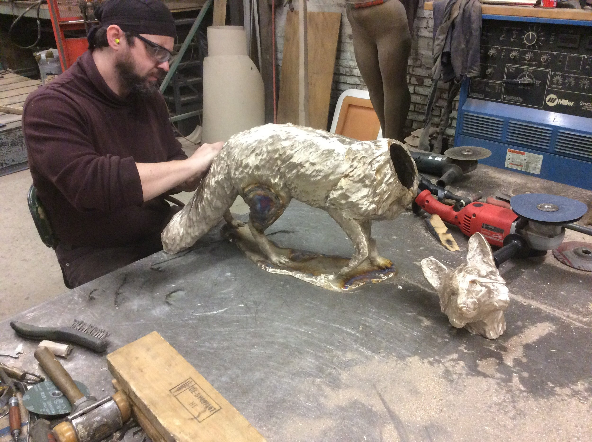 "Jason is finishing up the metal chasing on ""Scarlett"", the mama fox."