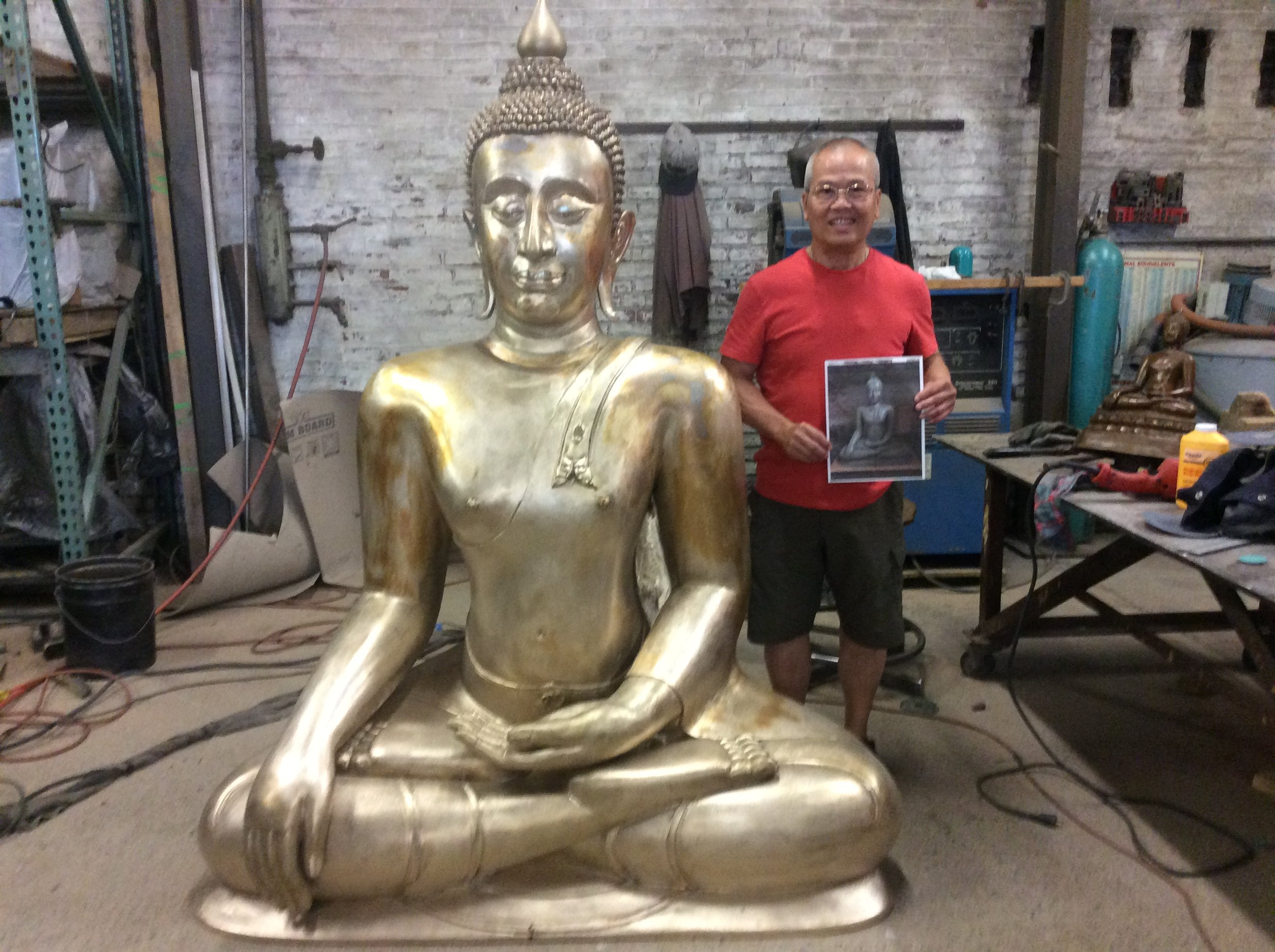 Artist and foundry friend Vivat Hongpong with his seven foot bronze Buddha finished in metal and waiting for patina.