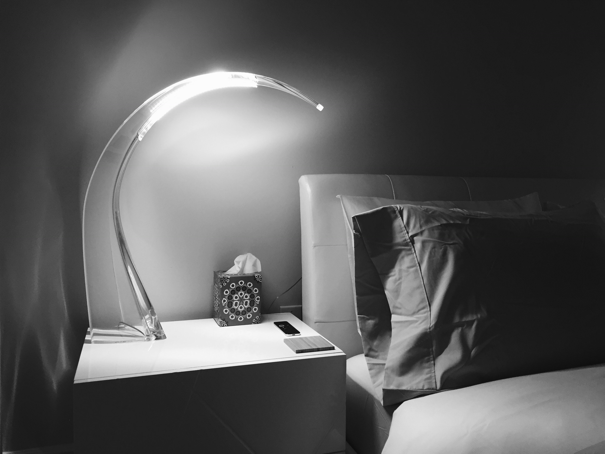 The Taj Table Lamp - Described by designer Ferruccio Laviani as both essential and bold, the Kartell Taj LED Table Lamp is uncluttered, minimal, and incredibly sensual. The strength of the piece is instantly evident (inspired by the graceful curve of an elephant's tusk), and the touch sensor/slide dimmer is intrinsic to the fixture, located right below the LED array.