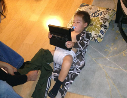 """Ben's """"blended life""""! Plays on a iPad while Mom changes his diaper."""