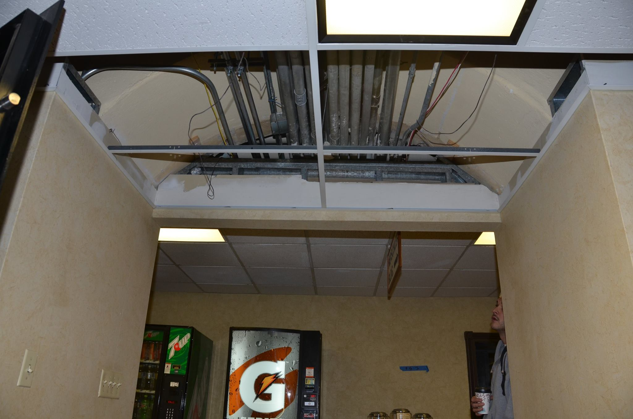 Historic Arches Hidden  Above Suspended Ceiling Tiles