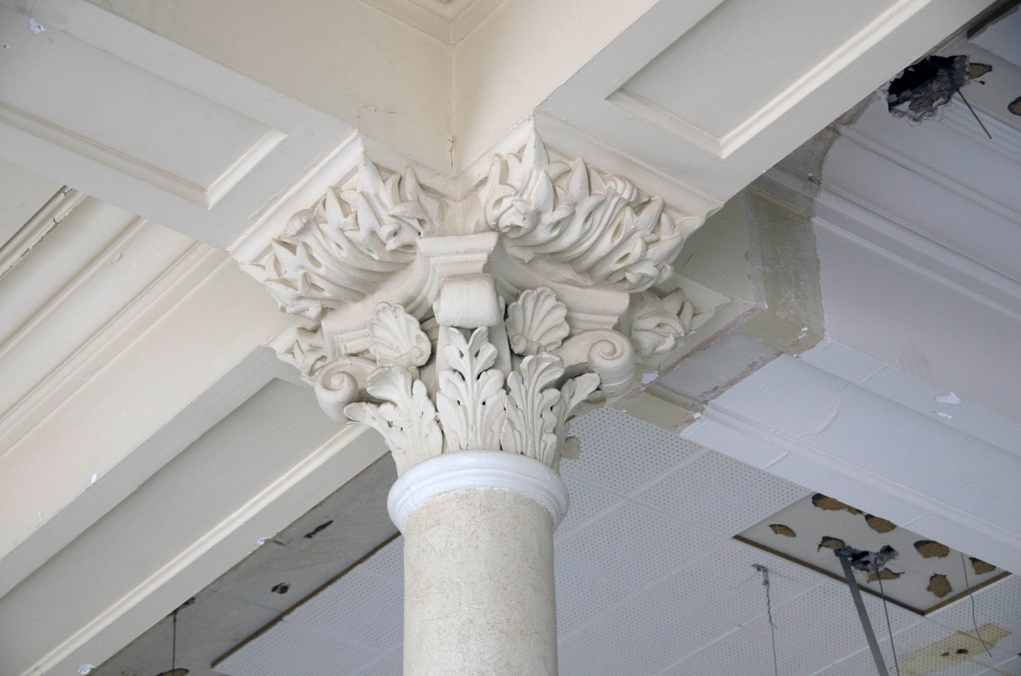 The removal of the dropped ceilings has uncovered hidden archways,coffered ceilings, historic paint, and decorative columns. The invasive infrastructure work necessary to repair the building allows for the restoration of many of these elements.