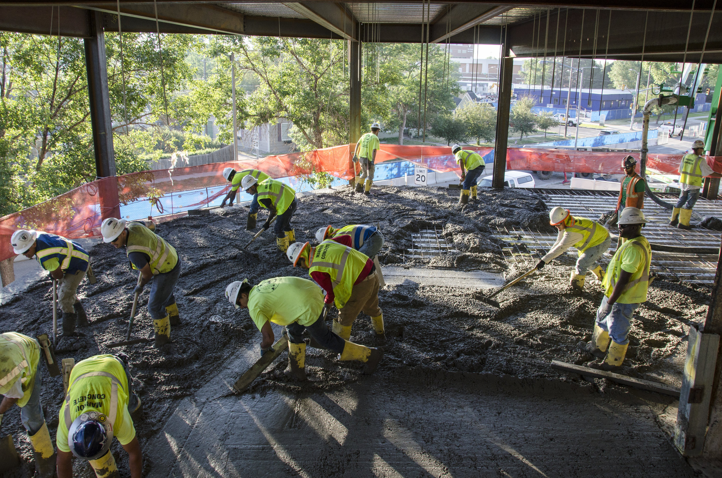 The concrete pour started on the second floor with a team of workers.