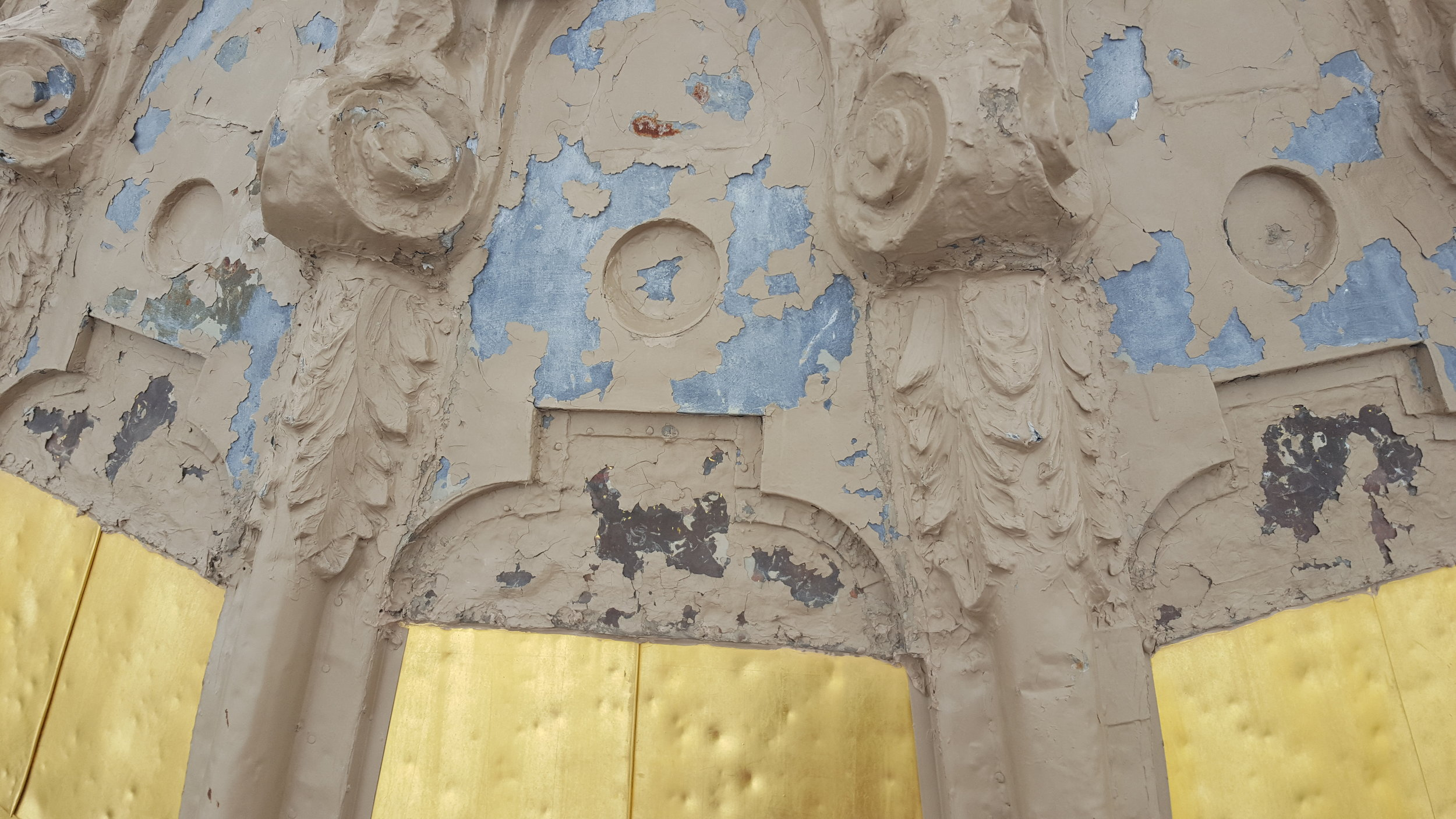 Hail damage and deterioration of materials are evident on the dome.