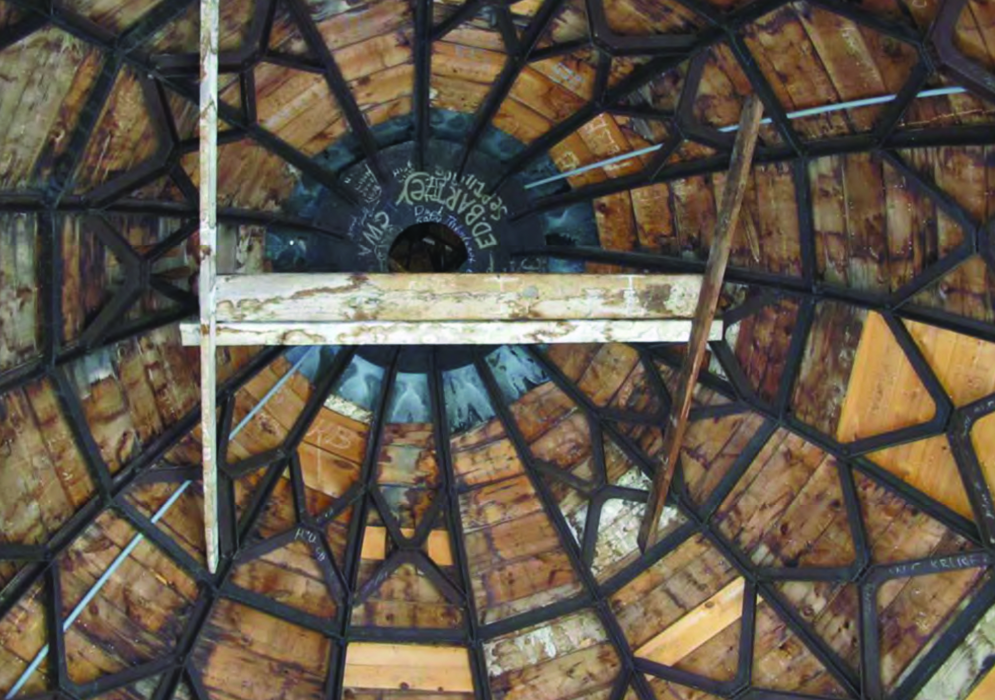 Widespread moisture damage is shown on the underside of the dome wood decking.