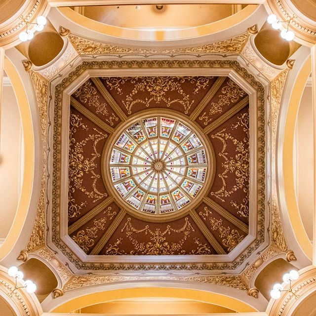 The restored 1888  trompe l'oeil paint pattern frames the beautiful stained glass lay light in the Capitol rotunda.  The Capitol is reopening after a critical restoration with a celebration on the afternoon of July 10, Wyoming Statehood Day. Come join us!