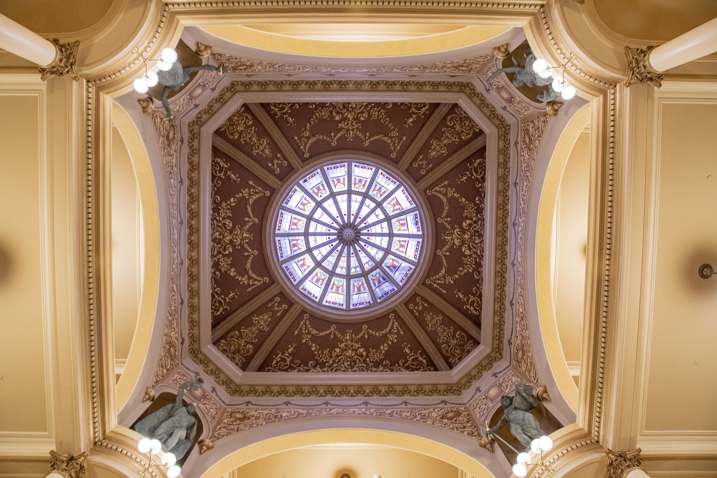 Surrounded by the recently restored 1888 decorative paint, four new bronze sculptures now stand in niches in the rotunda of the Wyoming Capitol.