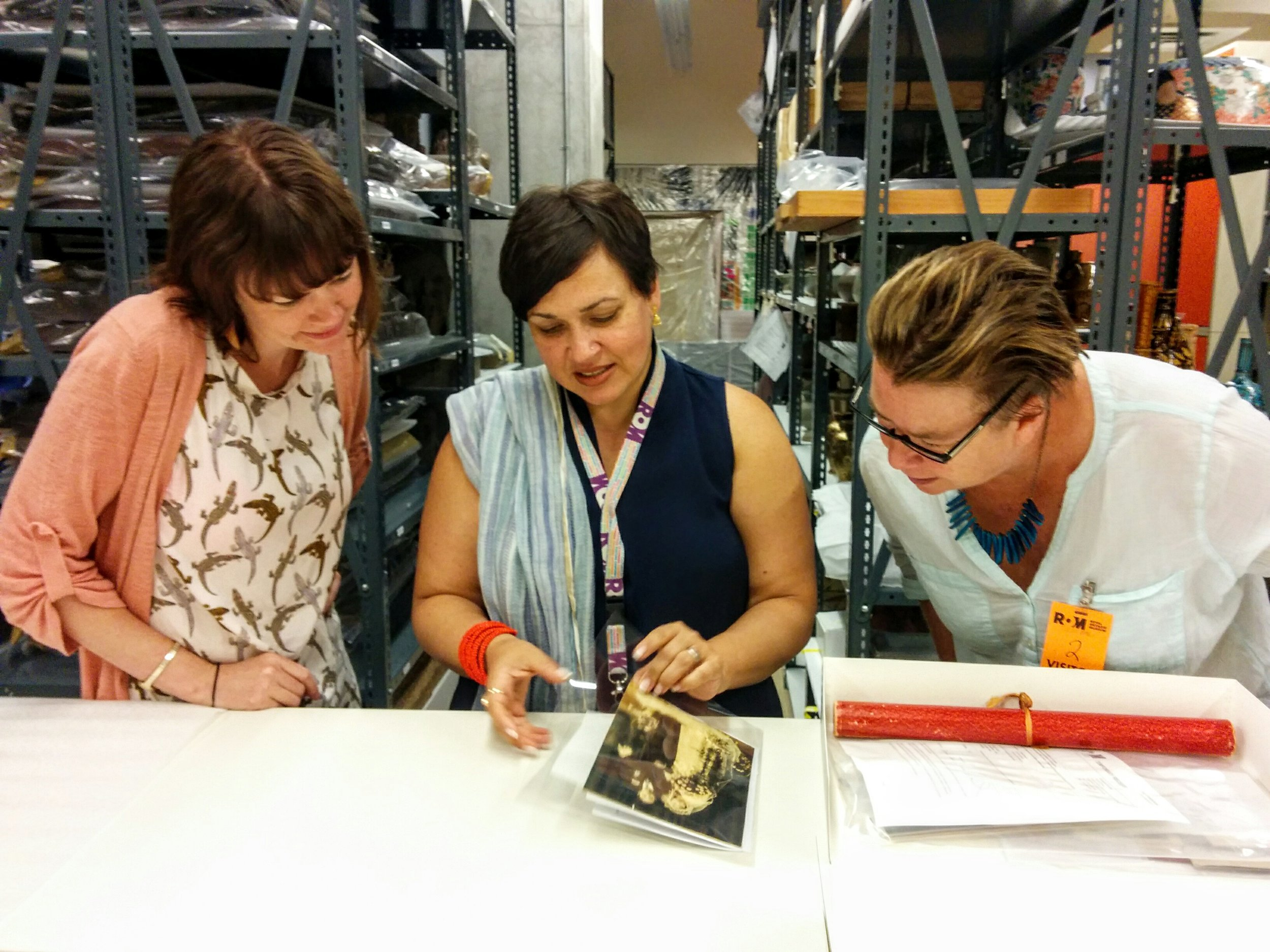 Julienne Pascoe consulting with Deepali dewan and Elspeth Brown at ROM (J. Orpana, 2017)