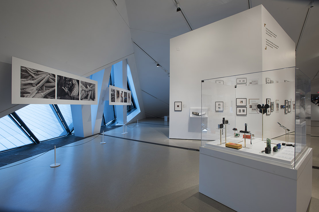 THE FAMILY CAMERA,  INSTALLATION VIEW, 2017.  Large Photographic panels on the left from left to right:  Husking and Braiding White Corn  (J. Thomas, 2017) and  Happy Father's Day  (J. Thomas, 2015). Courtesy of the Royal Ontario Museum © ROM. Photo Credit: Brian Boyle, MPA, FPPO.