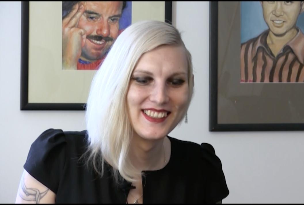 Video still of Jade Pichette in interview at the Clga (2018).