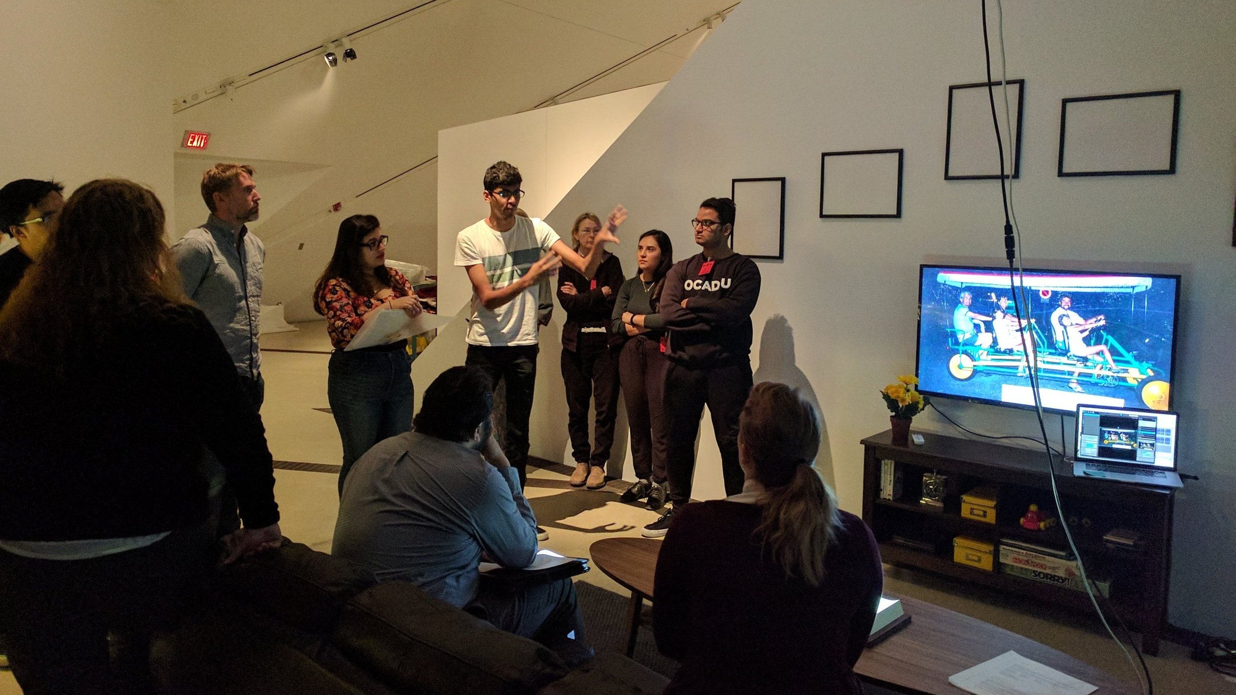OCAdu students installing  the living room  for  the family camera  exhibition (j. Orpana, 2017)