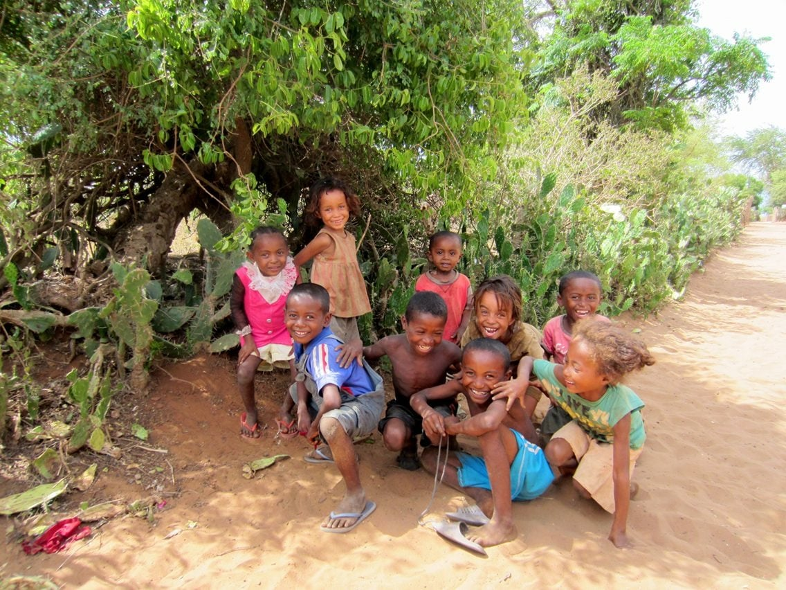 "But you can find them hiding in the shade. As I passed these kids, they sang ""Hello! Hello! Hello!"""