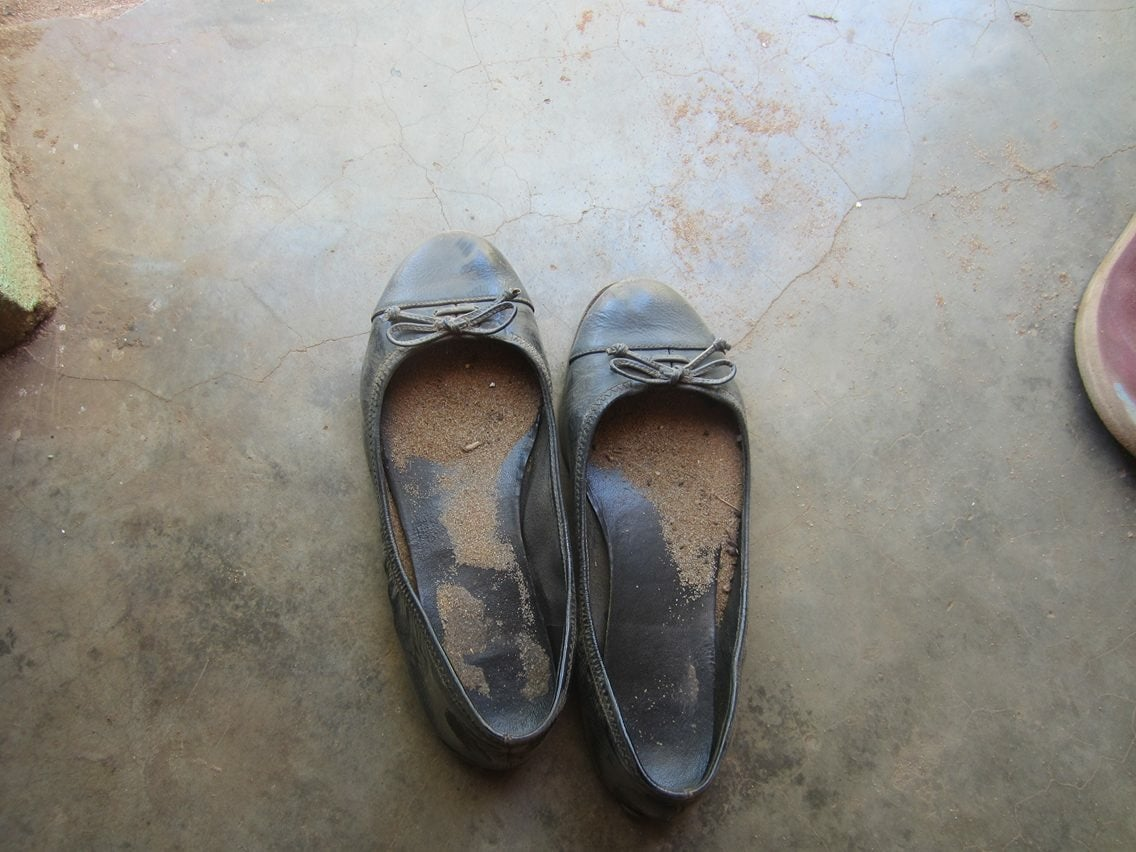 "My ""teacher shoes"" are always filled with sand by the time I return home. Almost everyone wears flip flops, though many of my students do not have shoes and walk barefoot to class in the burning sand."