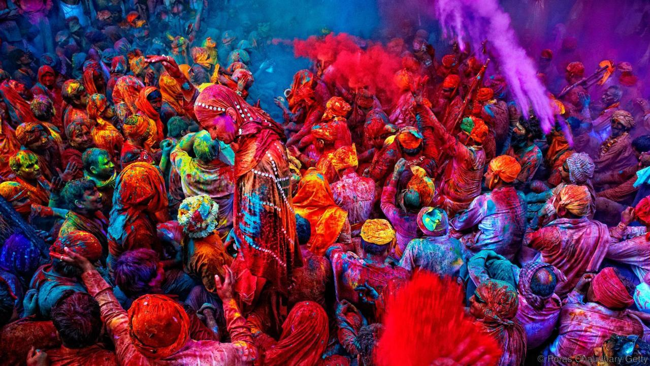 India's holy festival of colors - Celebrate the end of winter at Holi, an exhilarating Hindu festival that welcomes in spring through the throwing of vibrantly coloured powder. //BBC Travel