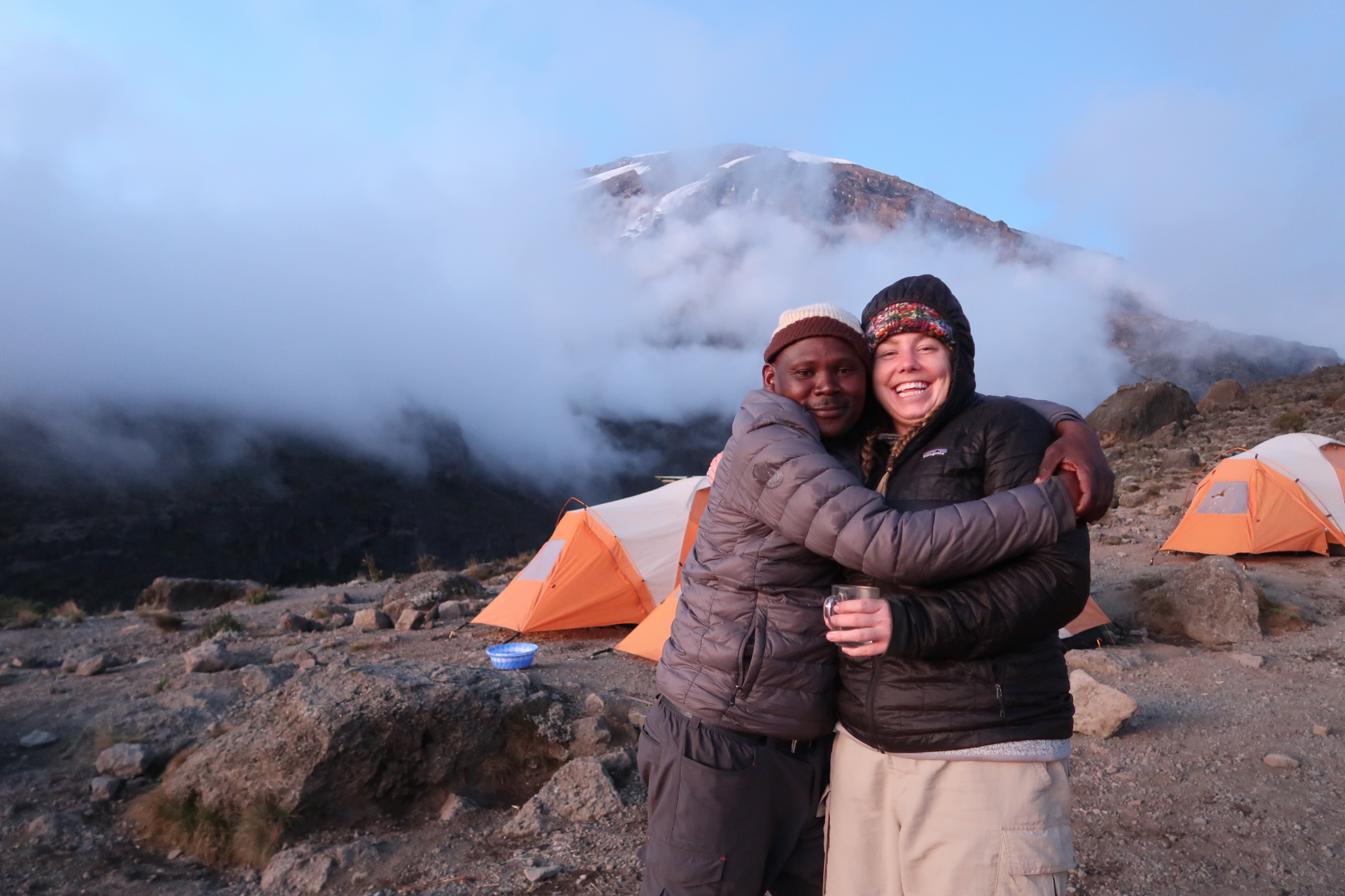 Prosper and me at Karanga camp at 3,900m. Kili made a quick appearance and then went back to hiding behind the clouds.
