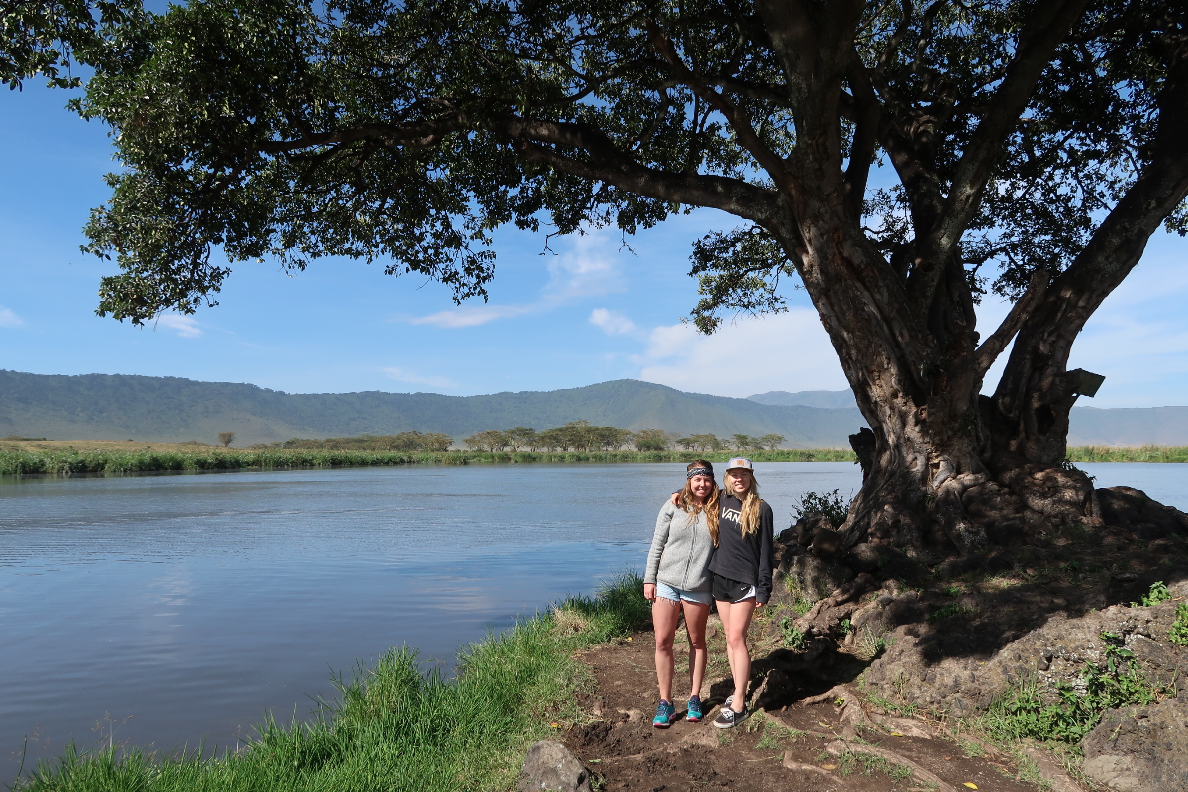 My sister, Molly and me at 'Hippo Lake' in Ngorogoro Crater. We drank coffee and ate breakfast while watching a dozen hippos, that seem to have disappeared for this photo, chill in the lake.