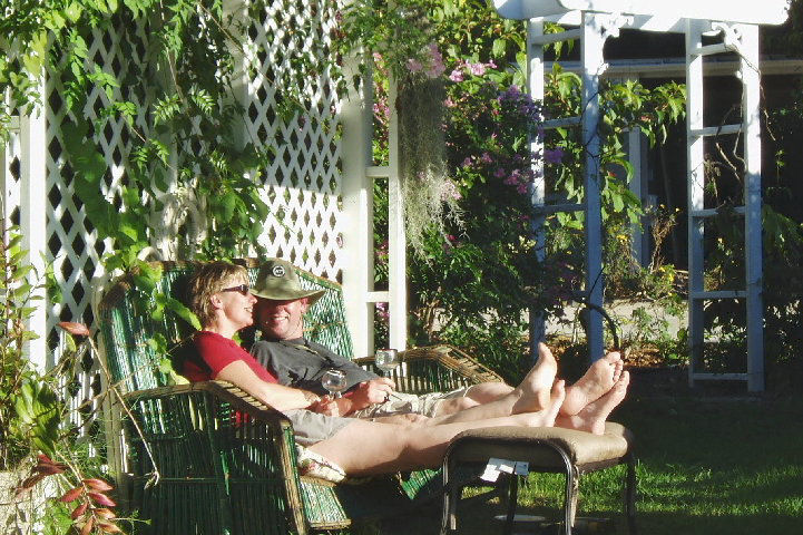 Guests enjoy the sun in the yard of the Hale Hookipa