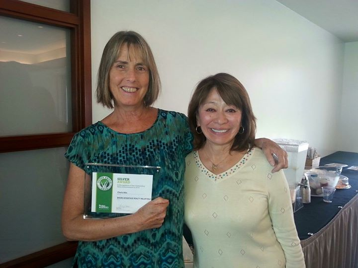 Cherie won the Better Homes and Gardens Real Estate Outstanding Sales Achievement 2014 — with Leslie Ann Yokouchi, owner of Better Homes and Gardens Real Estate Advantage Realty Valley Isle