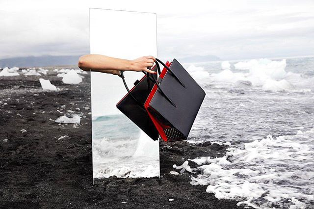 from @louboutinworld -  Back to Black. Paloma Ultra Black debuts in striking black-on-black, accented with sensual splashes of Christian Louboutin's signature red.📸@guillaumefandel - #Louboutin #on_location #mirror #landscape #iceland #vik #diamondbeach  Special thanks to @ylvafalk and @sophie_lemedioni ✊👌✊