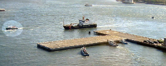 An Aerial View of the Launch and Other Escort Vessels Preparing for President Bush's Arrival