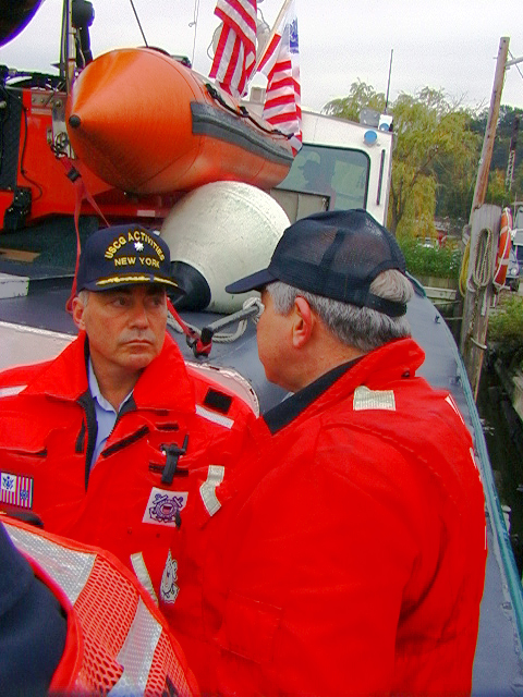 USCG Commander Jim Munro chats with Lou Liotti (USCG Aux) aboard Launch 5 before getting underway