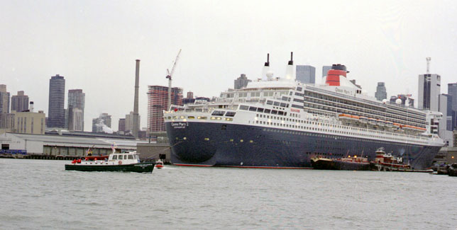 Launch 5 provides the scale for QM2 (photo by Bill Smith)