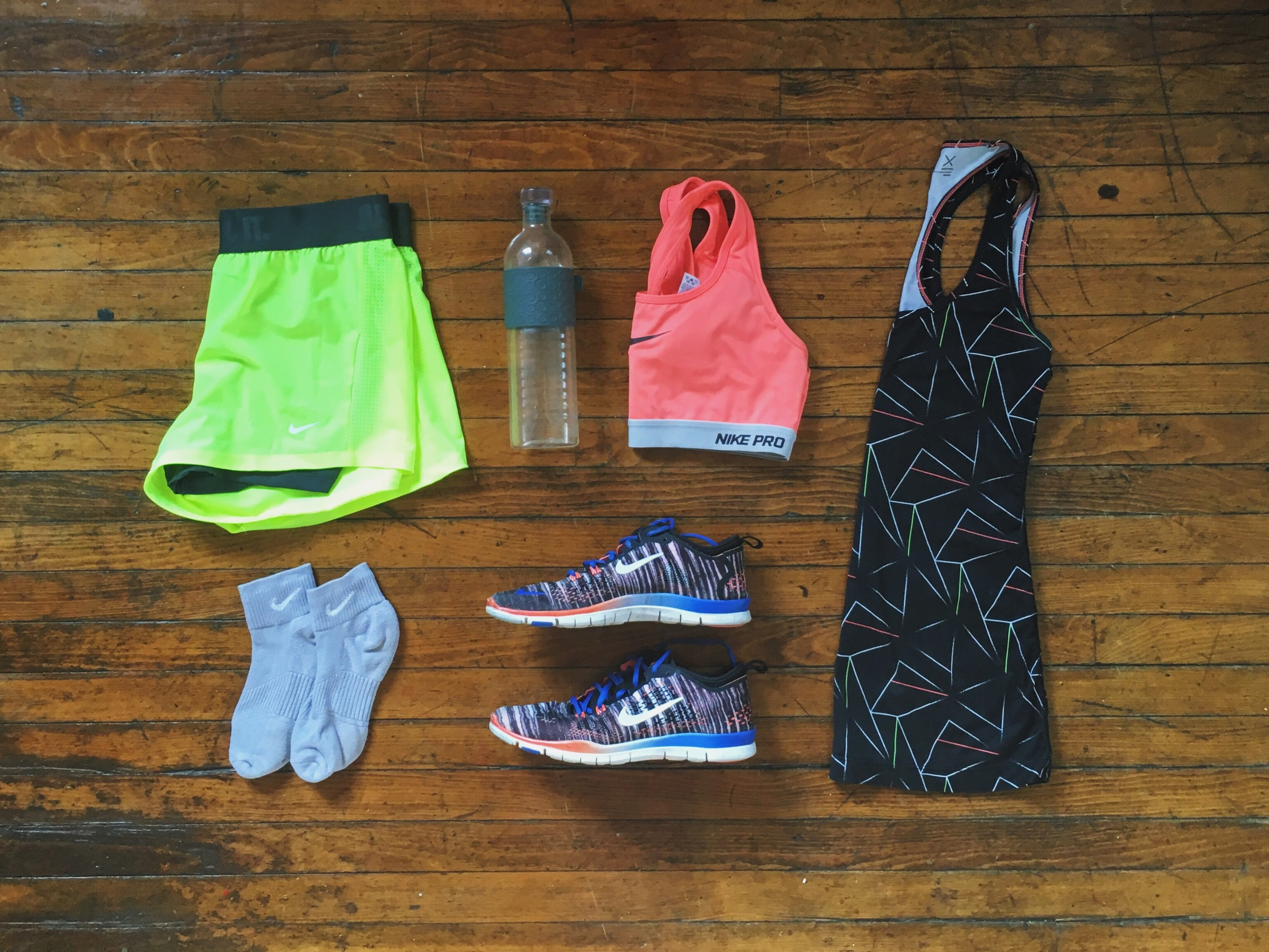 (1) Shorts:Nike (2) Socks:Nike (3) Sports Bra:Nike (4) Shoes:Nike (5) Tank: JC Penny