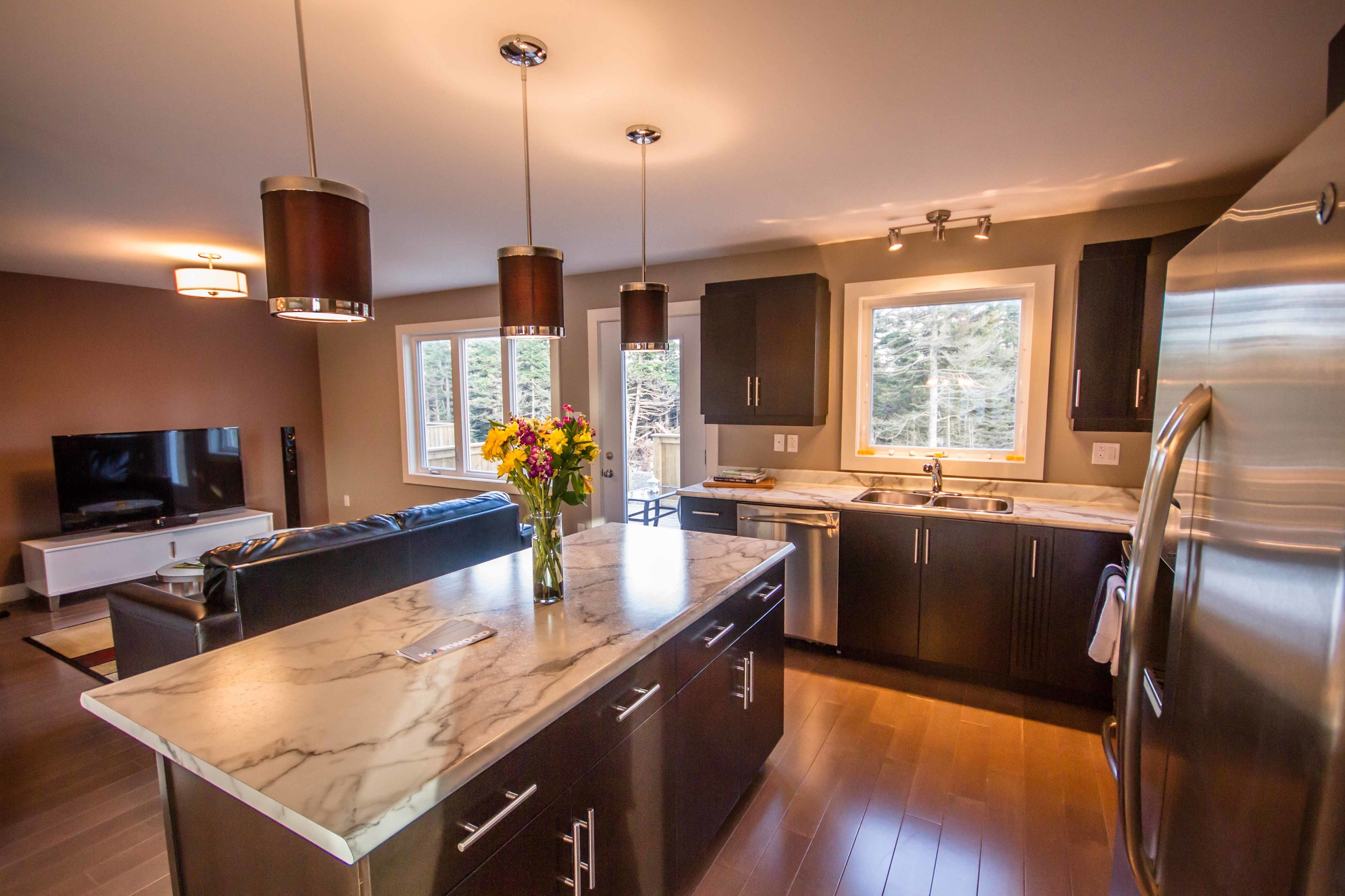72 Kenai Crescent - Kitchen and Den.jpg