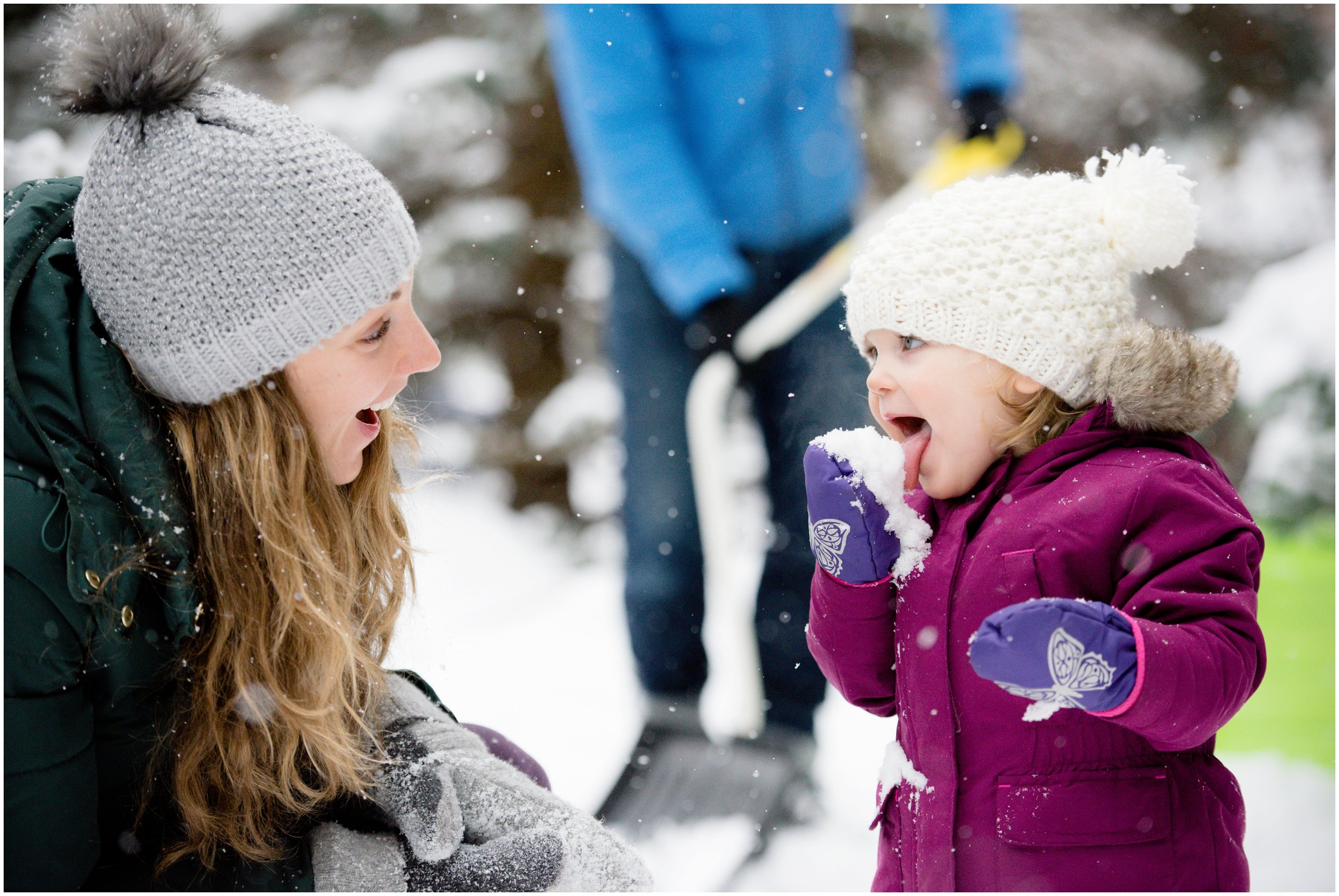 Mom and daughter in snow