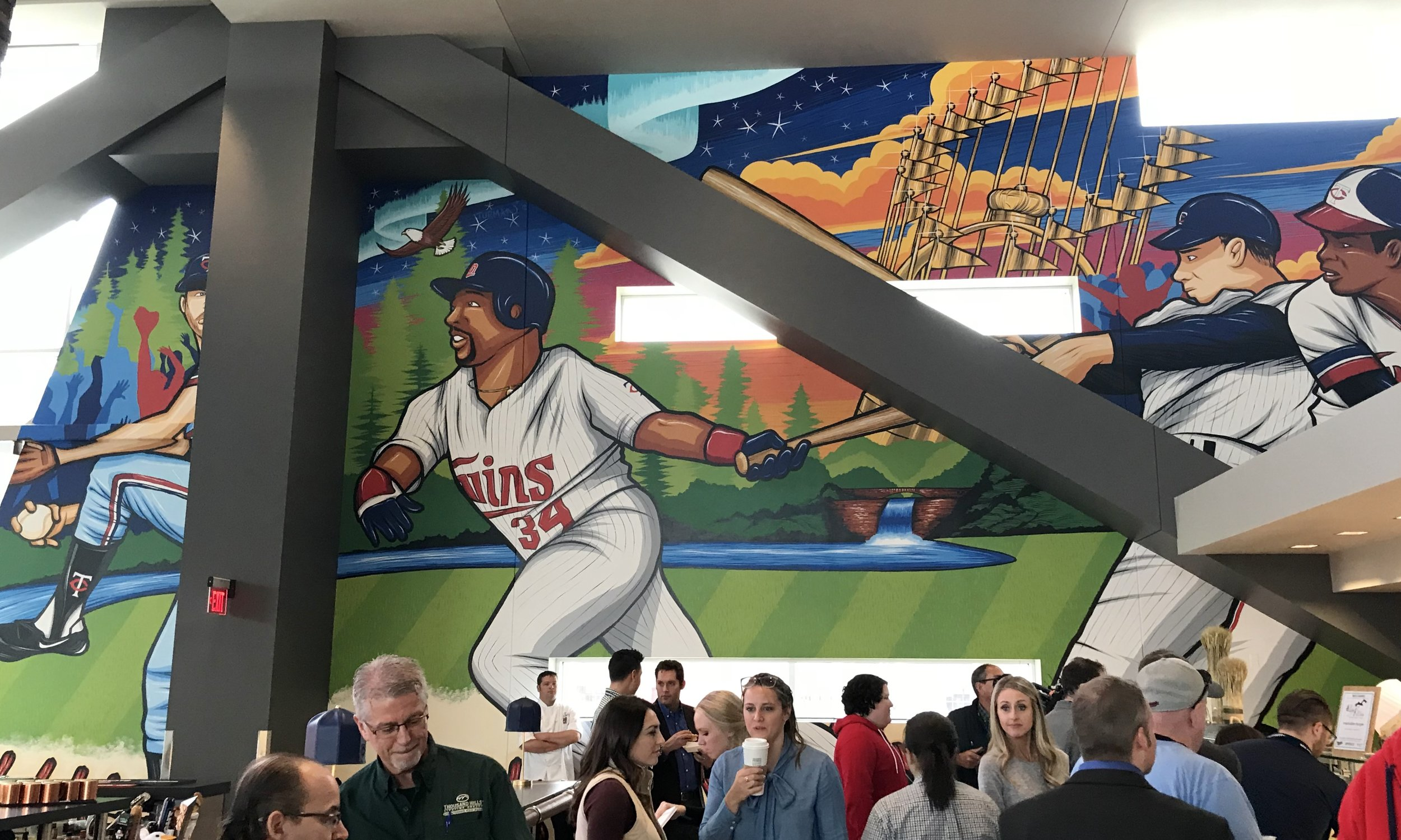 Adam's Bat & Barrel creation –   Northern Lights   – adorns the two-story southern interior wall of Target Field's new restaurant