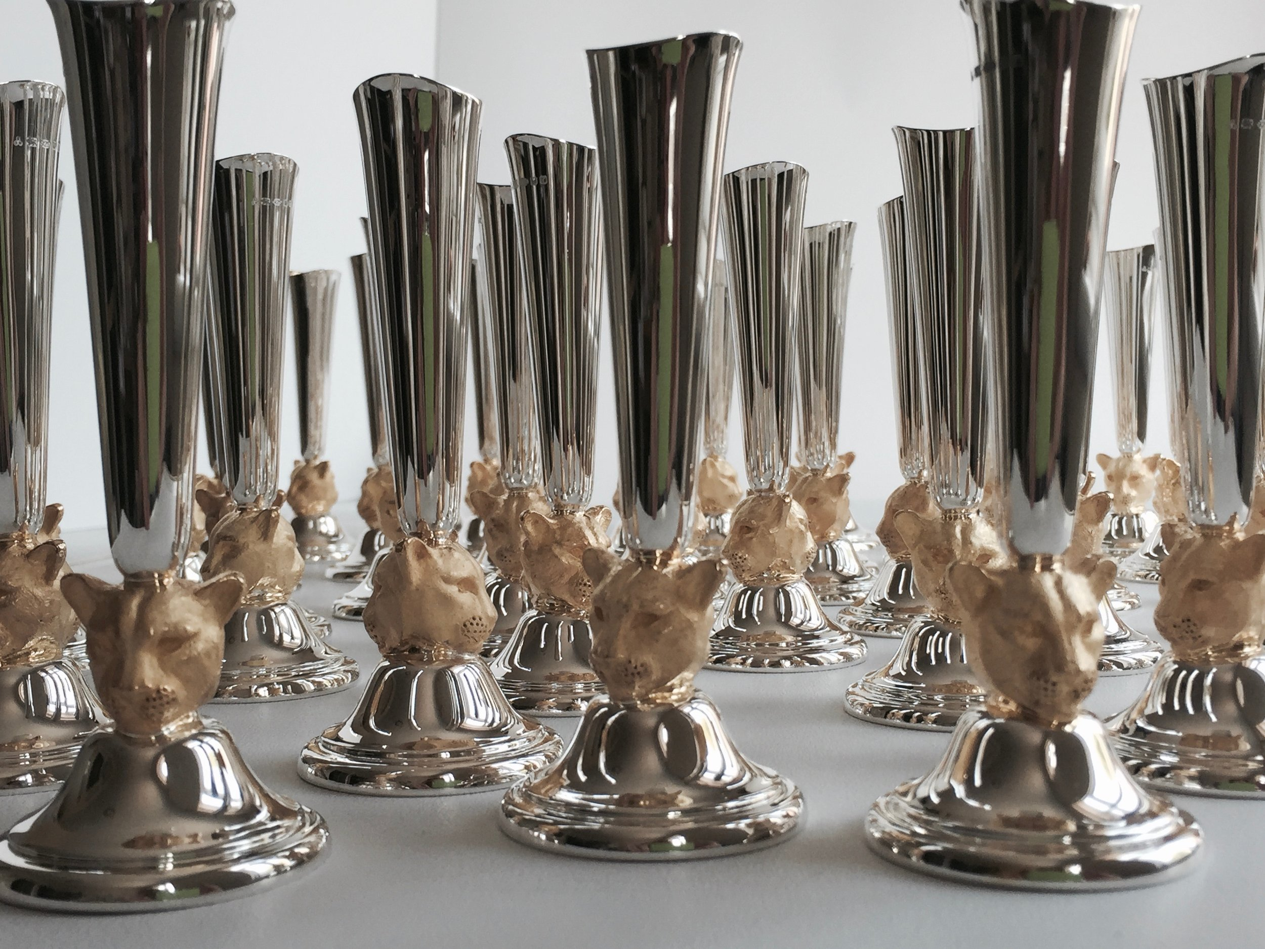 Close up image of multiple bud vases with leopard head