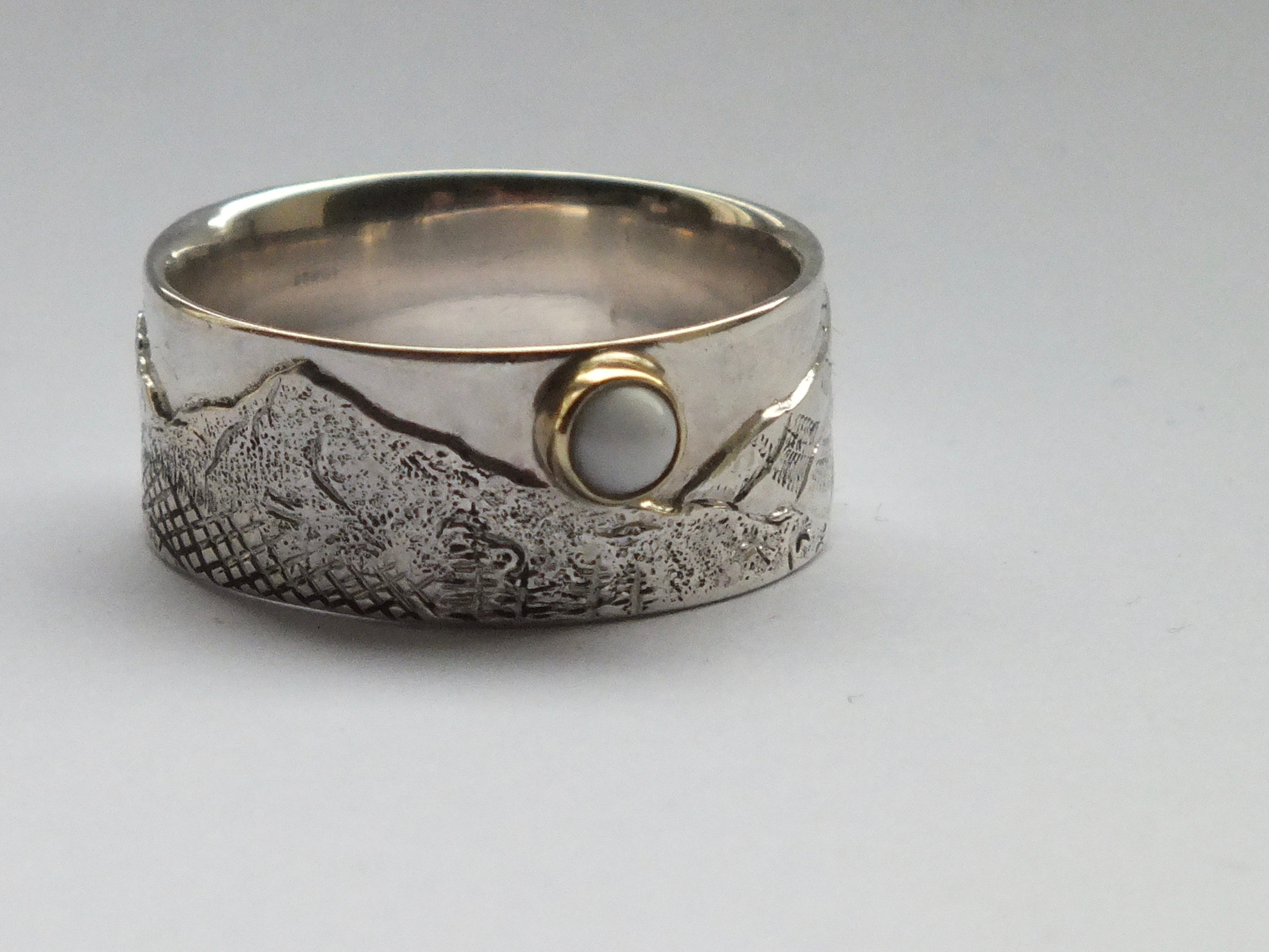 Chased and engraved ring of Oregon landscape with pearl, private commission
