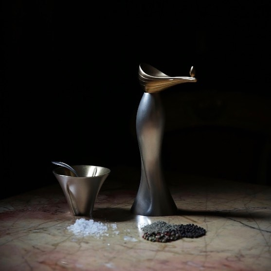 Open salt with pepper grinder ... Feeling so fortunate to be one of the smiths featured in the 'Made for the Table' exhibition, now on show at #thegoldsmithscentre until 31 August ..... an extraordinary celebration of fine dining with contemporary silver, glass, ceramics, textiles and a spectacular table and chairs commissioned special for the exhibition, by #thegoldsmithscompany . If it's getting too hot in the City, go check it out for a cool experience 😃  Gorgeous image captured by #her_dark_materials and styled by #avmcuriosities and huge thanks to #goldpolishingguru for such a beautiful finish on the silver and gold!! ************************************ #silver #silversmithing #handmade #madeinbritain #tableware #luxury #silverware #homedecor #goldsmiths  #shannononeill #contemporysilver #bespokesilver #commission #rosatkinson #handcrafted  #artistsoninstagram #style #saltandpepper #luxurydiningtable #eatinginstyle #tabledecor #musthave