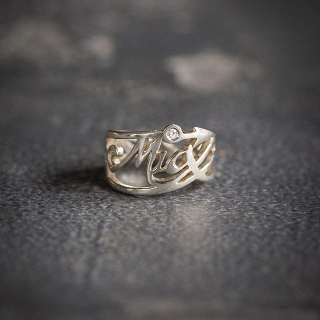 Happily delivered this specially commissioned ring, by @her_dark_materials for 'The Princess', @miyahrobin 20th birthday present. 🎁  A diamond accents the top of the 'i' ..because she's a diamond, ... an d to the right, an arrow head for her mastery in archery. On the other side, their special symbol of '381' ... 3 words, 8 letters, 1 meaning = 'I love you!' ❤️ Thank you her @_dark_materials for the great commission and those beautiful images too! ************************************* #handmadejewellery #madeinbritain #luxury #luxuryjewellery #bespokering #her_dark_materials #silverware #goldsmiths  #shannononeill #design #contemporysilver #bespokesilver #commission #handcrafted  #artistsoninstagram #style #craftsmanship #shannononeillsilver #uniquering #birthdaygifts #finejewellery #dayslikethese  #miyahrobin #somuchfun❤️