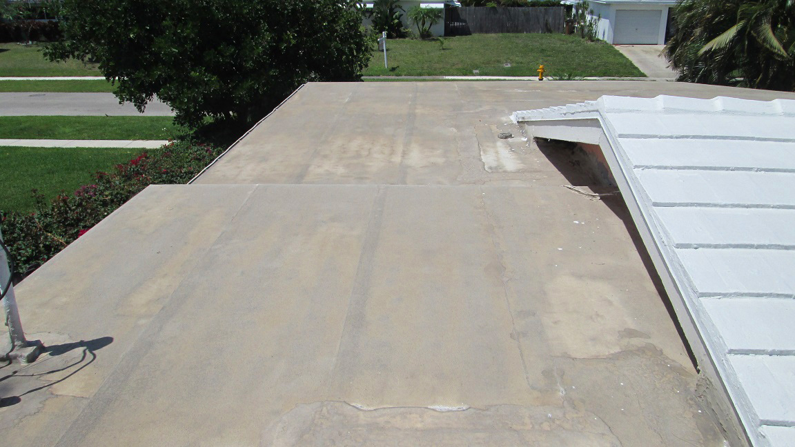 Silicone coating on a flat roof next to the tile portion which was done in acrylic.  Both roofs were done at the same time.