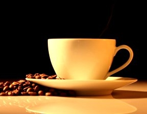 stock-footage-hot-cup-of-coffee-with-steam-on-a-wooden-table.jpg