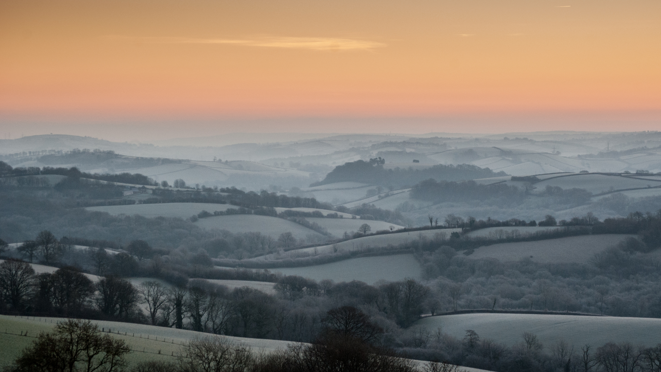Dawn above rolling hills on Exmoor, Devon