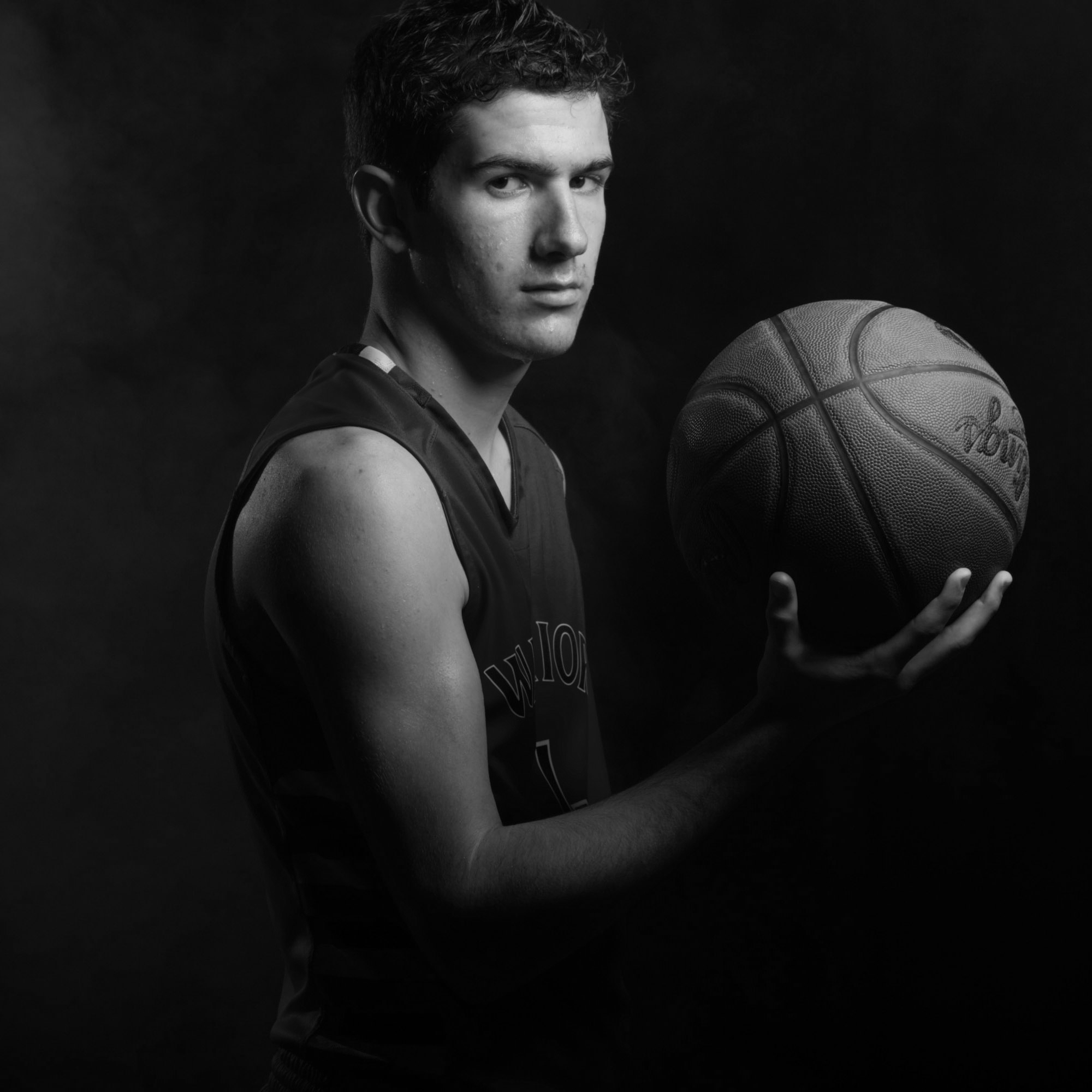 Photo 1  / Portrait photograph of Hunter holding a basketball.